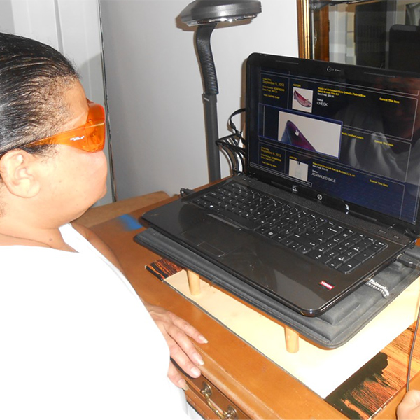 Angela using adaptive technology on her laptop