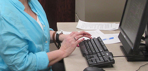 Photograph of woman on a computer