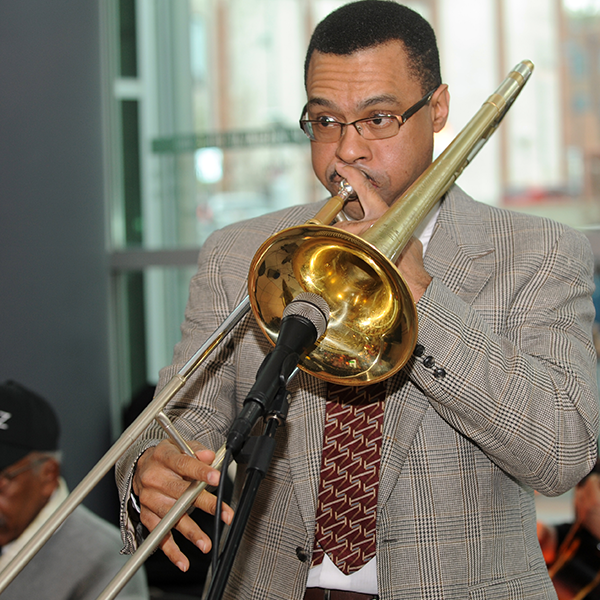 A jazz musician playing the trombone for the crowd at Wine & Whiskey 2017