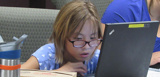 Image of youth exploring tablets at Technology Camp