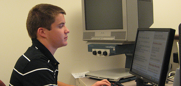 Image of one of our STEP participants working on a computer