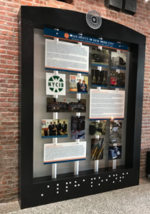 Display documenting the history of serving New Yorkers with vision loss