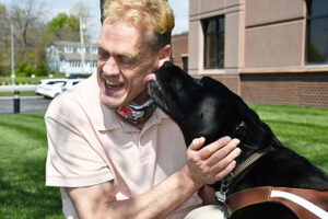 Image of Alphapointe team member Danny Jones with his guide dog, Teton