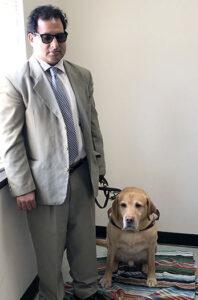 Image of Alphapointe team member Hari Dhoundiyal with his guide dog, Vital