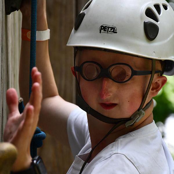 Adventure Camp participant Sebashton on the rock climbing wall